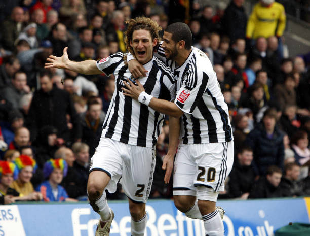 Former captain, Fabricio Coloccini celebrates scoring the opening goal with Leon Best in a 2-1 victory against Watford in February 2010. Picture courtesy of Getty Images.