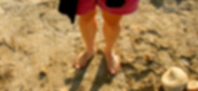 Student feet on beach.
