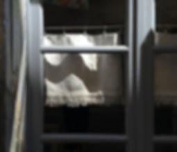 Window in half shade at noon.