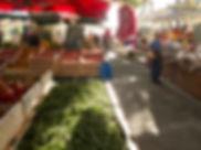 Vegitable market in early morning sun.