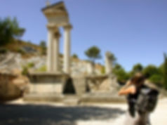 Student takes photo of Greek temple.