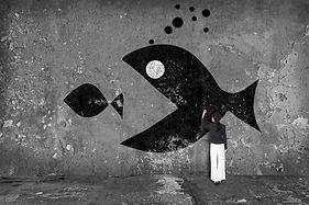 businesswoman drawing  big fish eat smal