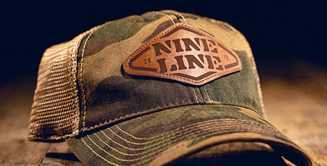 Nine Line Camo Trucker Hat with Stencil Patch