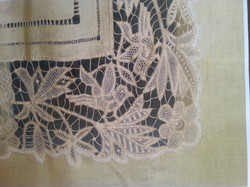 Curtains embroidered with Renaissance stitch.