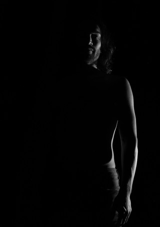 Figure, in the shadows