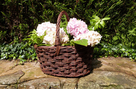 Rustic basket with fresh flowers
