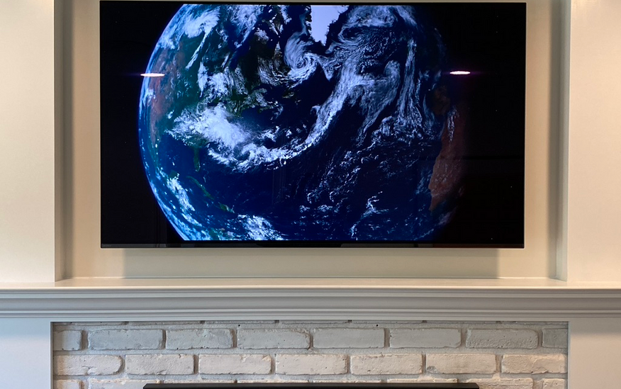 Sony TV on White Fireplace.png