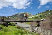 Hiker crossing a primitive bridge, Nebrodi Hikings