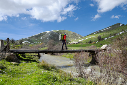 Hiker crossing a primitive bridge, Nebrodi Hikings