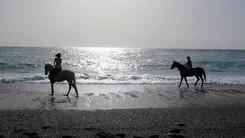 Passeggiate a cavallo in spiaggia, Sicilia
