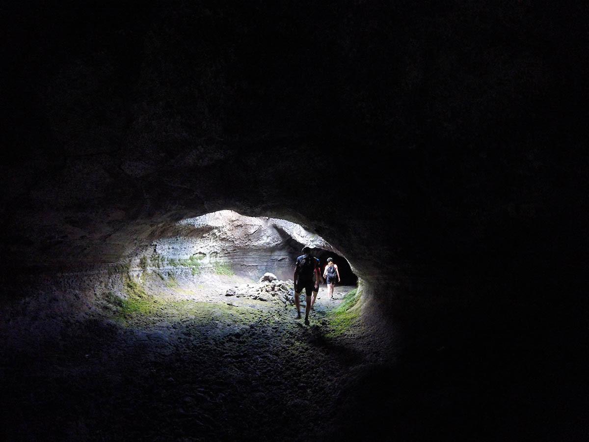 Walking inside a lava tube, Etna Biking Excursion