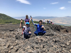 Little hikers on lava flow, Etna Hiking