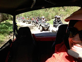 Guide lead people along a trail, Montalbano Quad Adventure