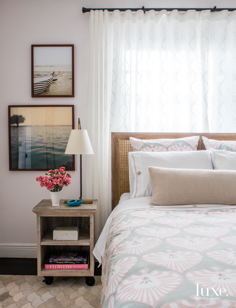 Delicate draperies from Wall Boutique add a serene vibe to a guest bedroom. The lamp, resting on an RH nightstand, and bed linens are by Serena & Lily.