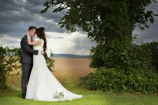 bride groom embraced