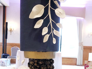 Modern silhouette with navy and gold marbling and handmade sugar leaves