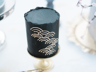A tiny cake full of drama with gold detailing
