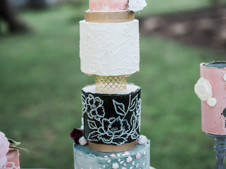 Tall handpainted statement cake with delicate hand piping and bold colors