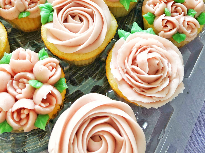 Hand piped raspberry rose cupcakes