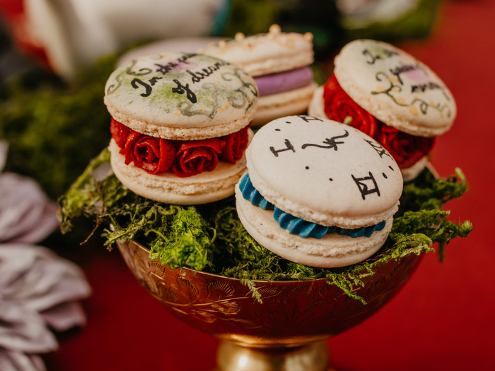 Hand painted macarons and hand piped buttercream rose centers