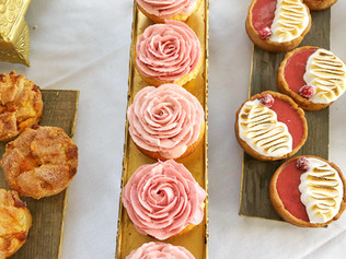 Stone fruit tarts, handpiped rose cupcakes, cranberry meringue tarts!