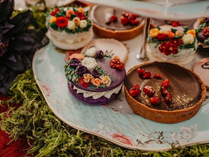 Chocolate pomegranate tarts, intricate garden macarons, handpainted sugar cookies