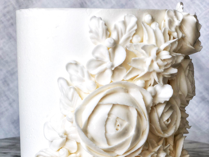 White on white bas relief cake