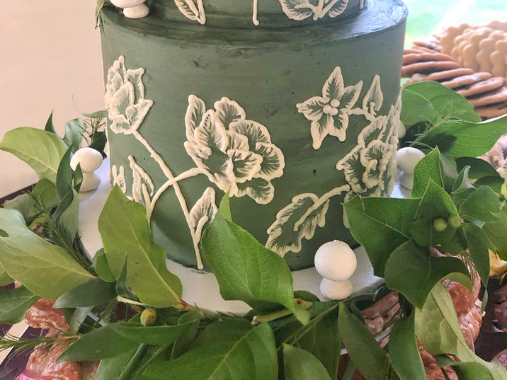 Mini mushrooms, greenery, and custom handpiping to match her dress!