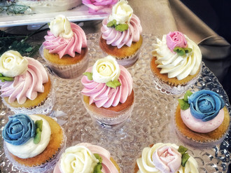 Handpiped and naturally colored buttercream roses