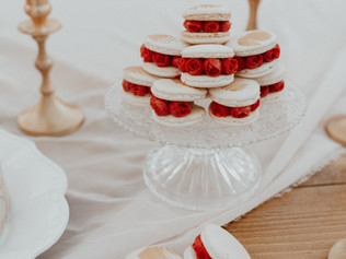 Delicate handpiped rose filled macarons