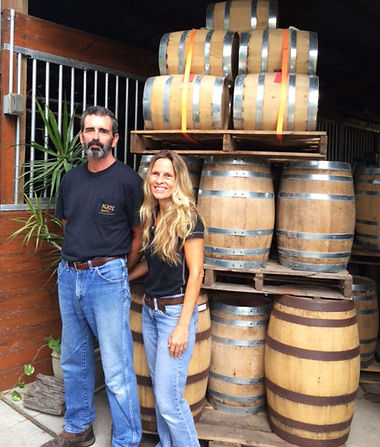 kevin and i at distilley -  barrels.jpg