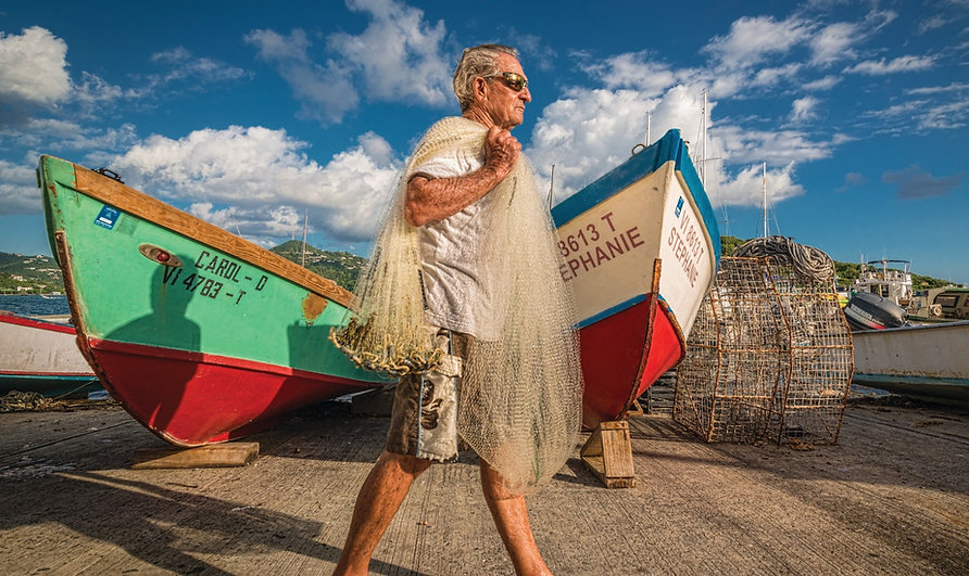 Fisherman carrying a net
