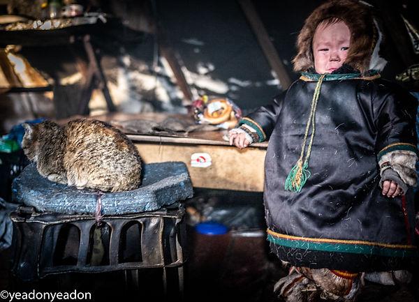 Frozen OB Highway - Nenets child inside the family Chum.