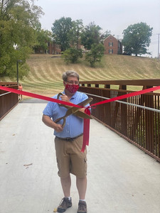 Mayor Smith cuts the ribbon at the grand opening of Phase 2 of the trails!