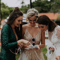 Wedding guests inspect their printed Kombi Booth photos