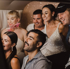 Bride & guests pose having their picture taken inside Kombi Booth
