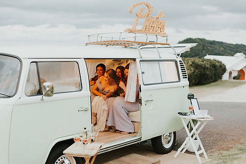 Wedding guests have photo taken inside kombi photo booth at summergrove estate