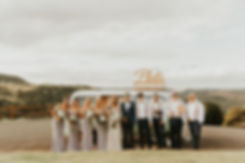 Bridal party pose in front of Kombi Photo Booth at Summergrove Estate