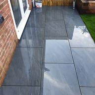 Uniform size grey paving patio