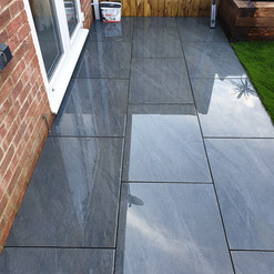Uniform size grey paving patio
