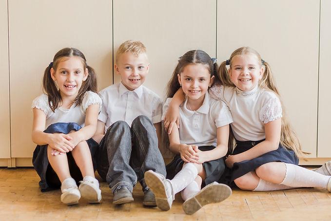 cheerful-kids-sitting-floor-school.jpg