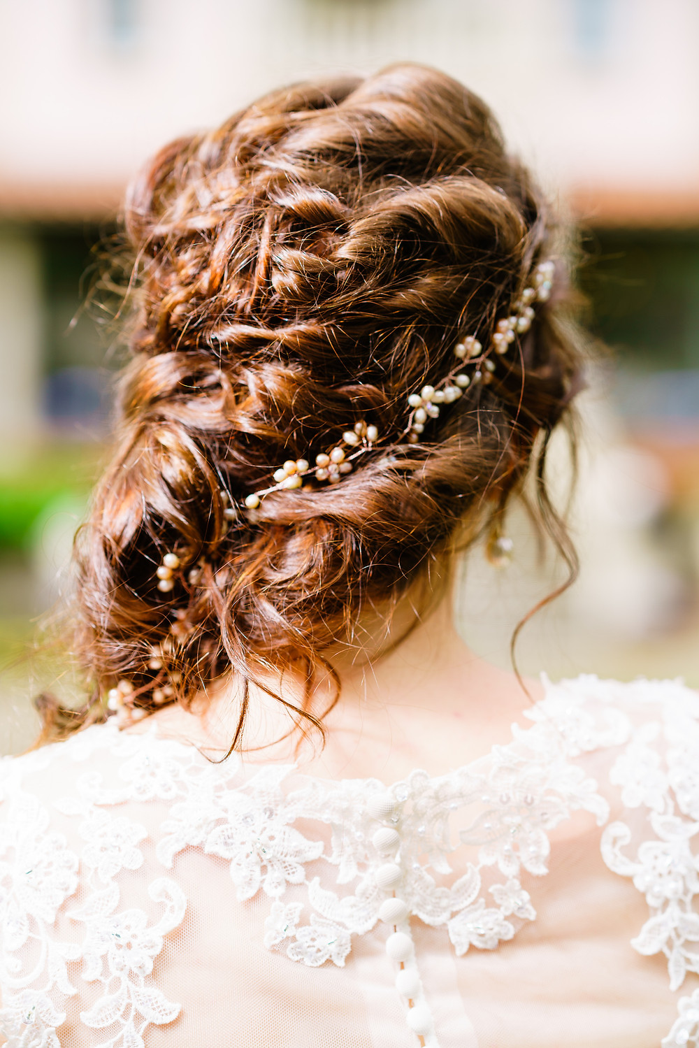 Loose plaited hair with a rose pink hair vine