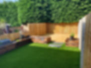 fencing-in-small-garden-sleeper-flowerbe