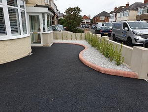 tarmac driveway with red brick edging