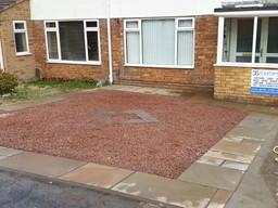 red-stone-front-garden