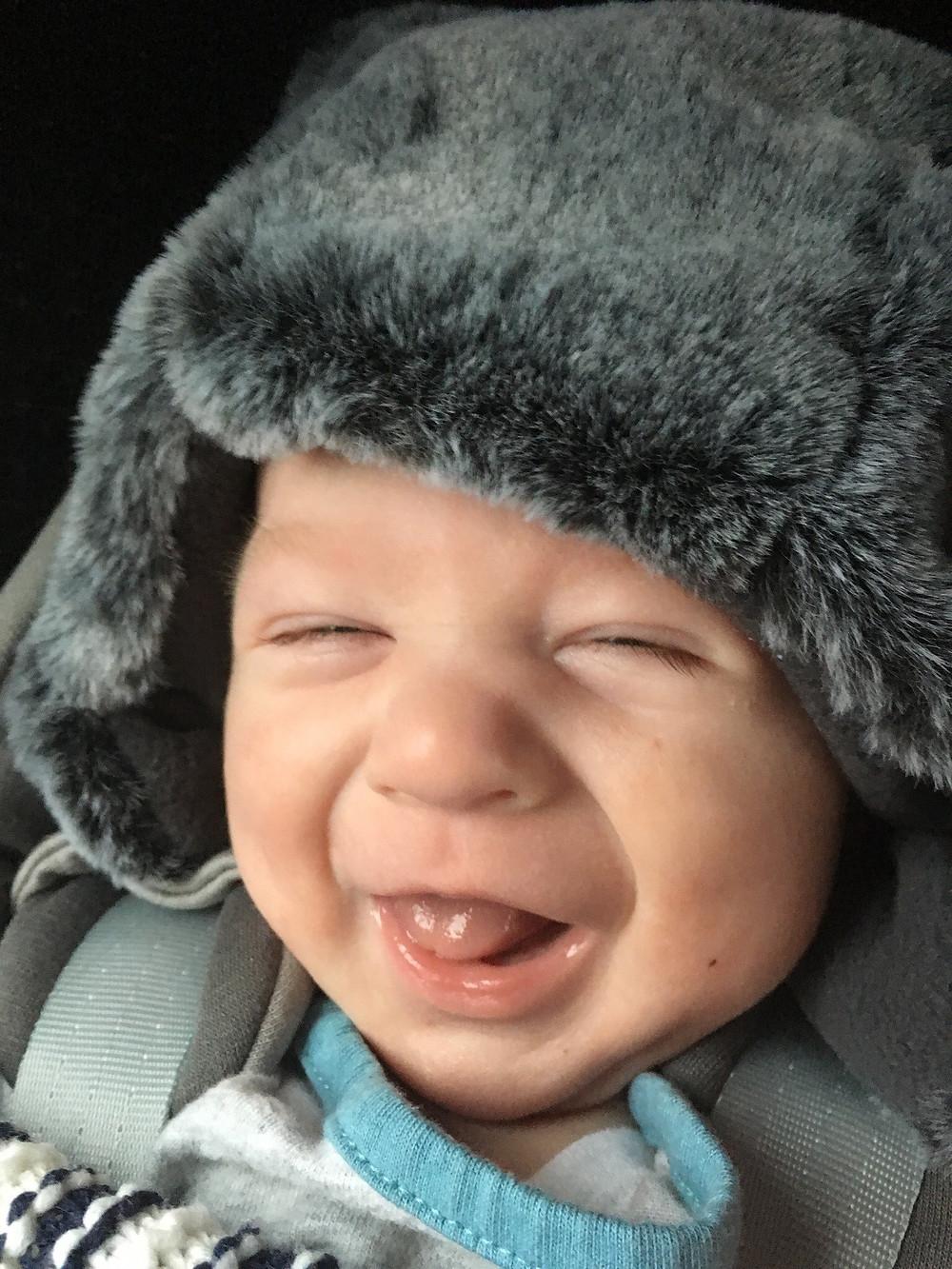 Freddie in his hat smiling