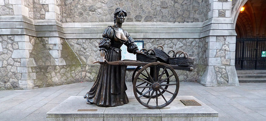 Bronze statue of a fictional fishmonger named Molly Malone, the star of a well-known Irish song.