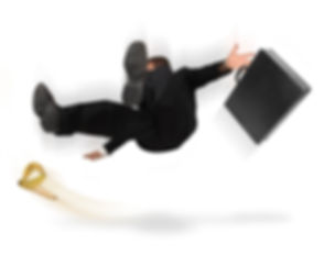 Businessman slipping and falling from a