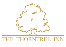 THORNTREE LOGO GOLD.png