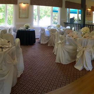 Wedding-Reception-White-Chairs.jpg